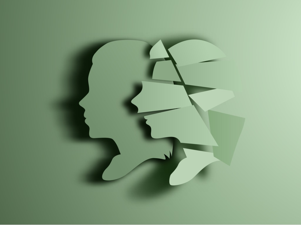 Green silhouettes of male and female heads: self-talk