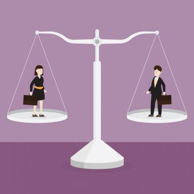 hiring trends: man and woman on set of scales